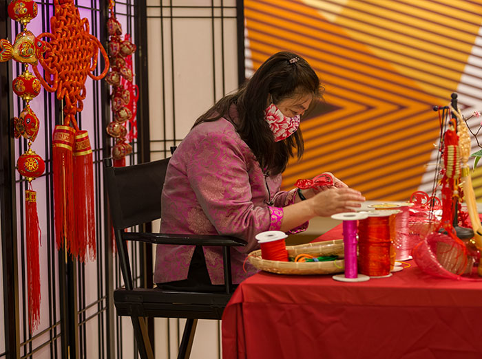 Artist working on Chinese Knot Tying