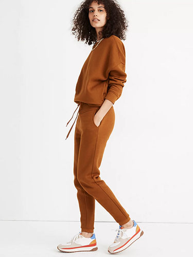 Model in matching terra cotta sweatsuit