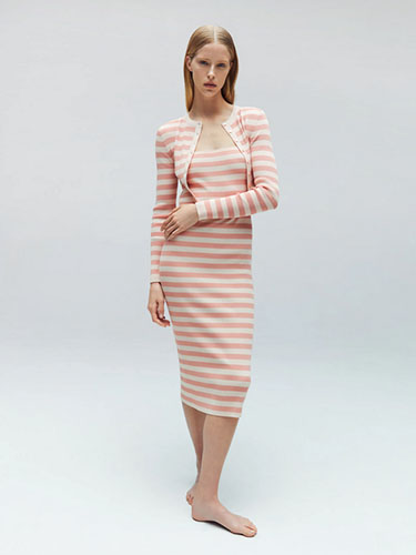 Model in stripe dress and cardigan