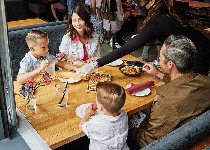Family enjoying dinner at restaurant